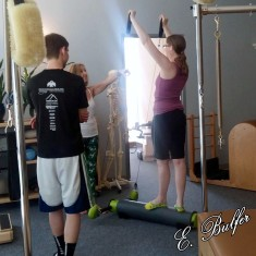 I'm on the MOTR, a relatively new Pilates device. It's extremely versatile. This was during an open house at my studio.