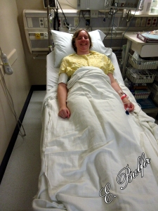 Lizz in her awesome medical gown. Add the bandage on the right and that's about how she looked when it was all done.