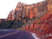 See that hole on the side of the cliff? Well, there is a VERY LONG tunnel in Zion, and that hole is for it. The tunnel is natural and does not have any lights at all, so there are some of these holes scattered through it.