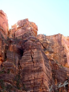 "Let's play ""find the rock climbers!"" There are three climbers, one actively climbing."