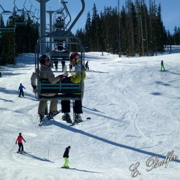 Becky and Dan riding the lift for our second run at the top!